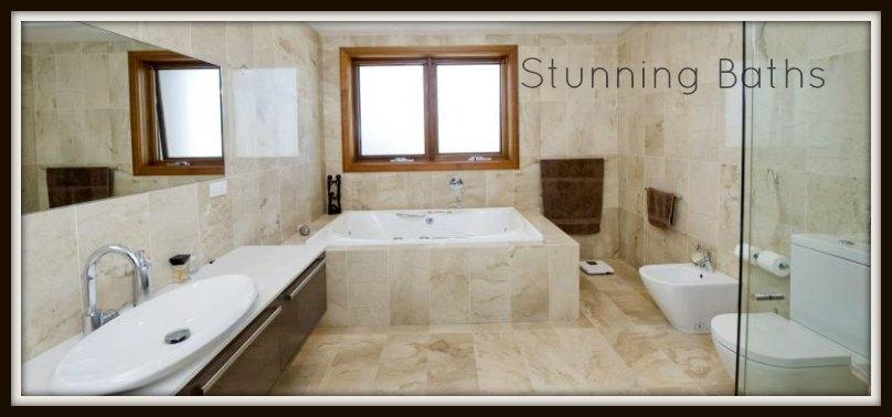 gorgeous stone tiled bathroom